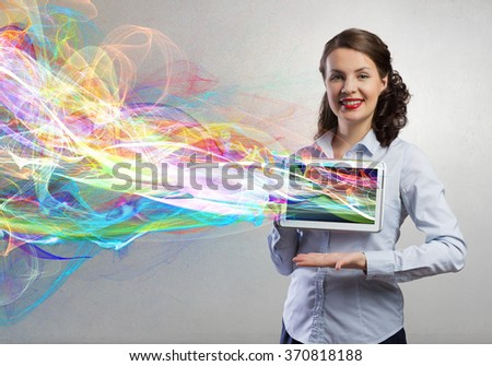 Woman presenting tablet pc