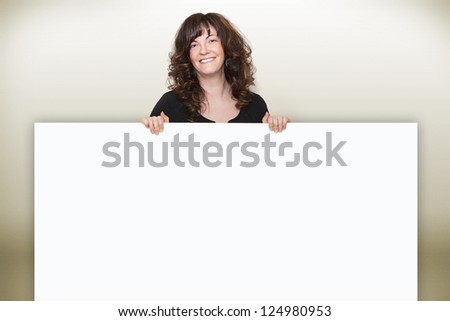 Woman presents information on board