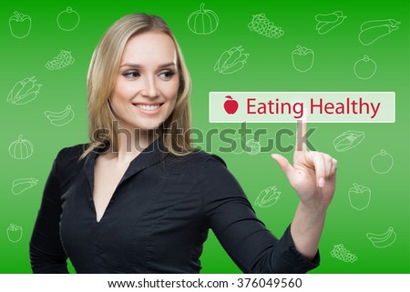 woman presses the button on virtual keyboard. touch screen. eating healthy - stock photo