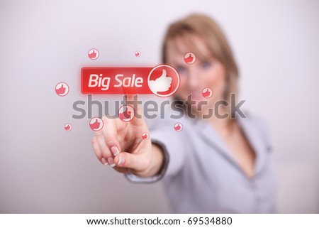 Woman pressing big sale button with one hand