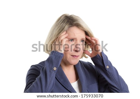 Woman pressing her fingers on her temples because of a headache or migraine, copy space, isolated - stock photo