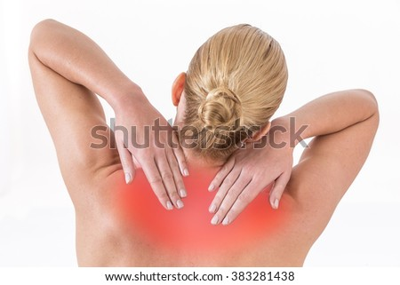 Woman pressing her hands against a painful shoulder - stock photo