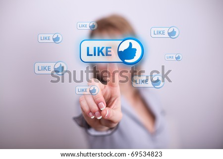 Woman pressing like button with one hand