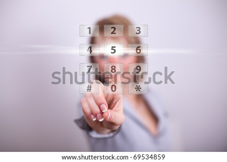 Woman pressing modern button with one hand - stock photo