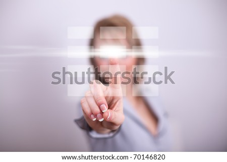 Woman pressing modern button with one hand