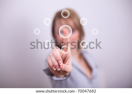 Woman pressing modern circular button with one hand