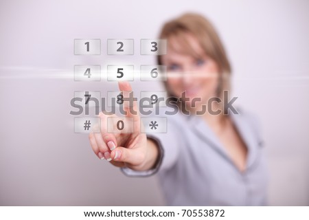 Woman pressing modern light button with one hand - stock photo