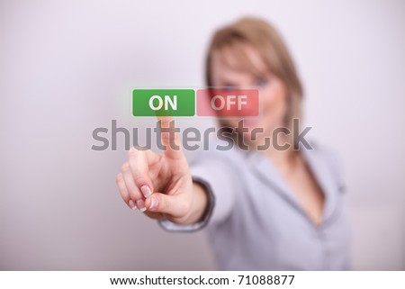 Woman pressing on/off button with one hand - stock photo