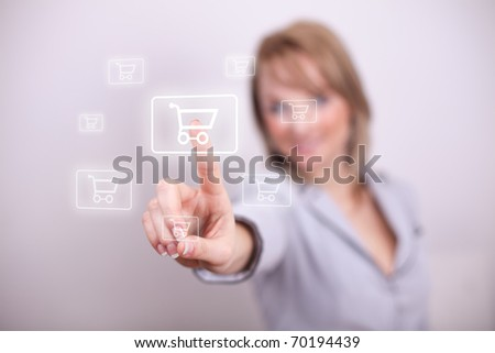 Woman pressing shopping cart button with one hand