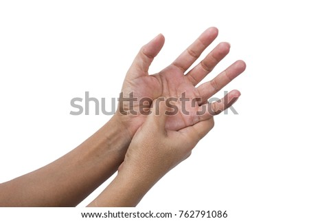 Woman pressing the middle of her palm with her thumb to relieve pain