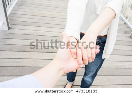 Woman preventing her boyfriend from leaving