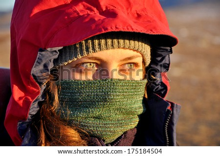 woman protecting face from a cold