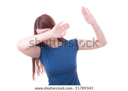 Woman protecting herself from aggression. Domestic violence. - stock photo