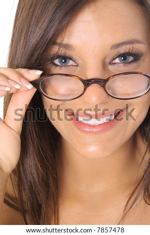 woman pulling glasses with a gorgeous smile