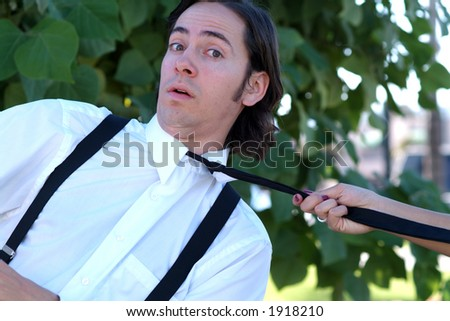 woman pulling on tie - stock photo