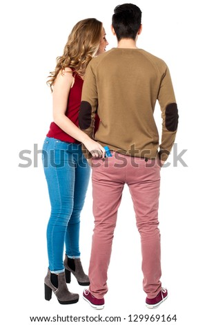 Woman pulling out the cash card from her boyfriend's pocket. - stock photo