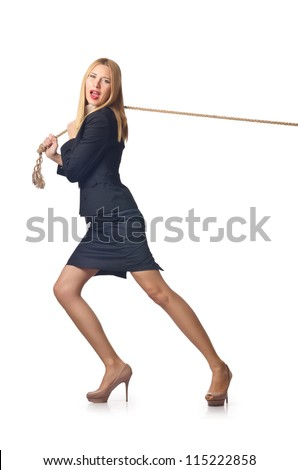 Woman pulling rope on white - stock photo