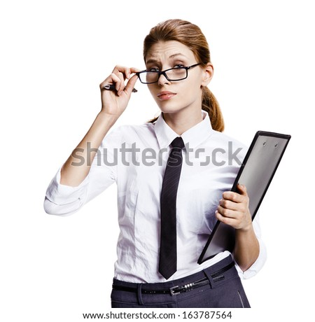 Woman pulls down her eyeglasses / portrait of young attractive brunette woman looking through half-mast eyeglasses - isolated on white background  - stock photo