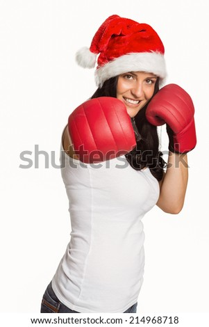 Woman punching with boxing gloves on white background