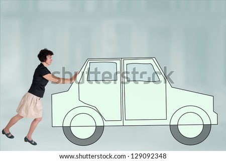 Woman pushes symbolically car