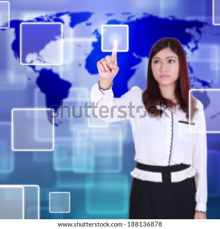 woman pushing button on a touch screen interface - stock photo