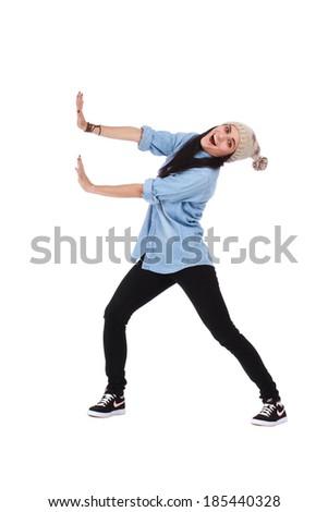 Woman pushing something imaginary - stock photo