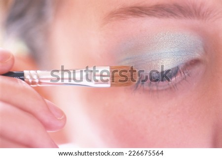 woman put on her make-up - stock photo