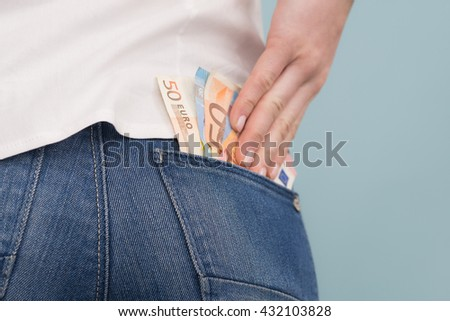 woman puts euro in the his pockets