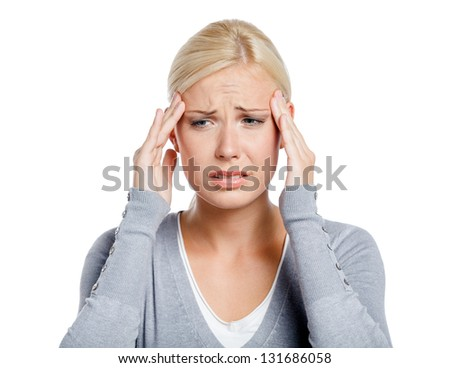 Woman puts hands on the head, isolated on white. Concept of problems and headache - stock photo