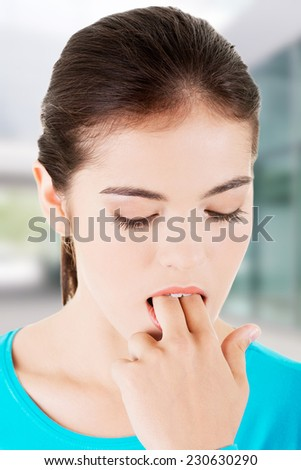 Woman putting her finger in mouth to provoke vomiting. - stock photo