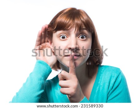 woman putting her finger to her lips for shh gesture - stock photo