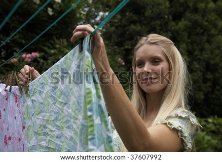 woman putting out the washing to dry