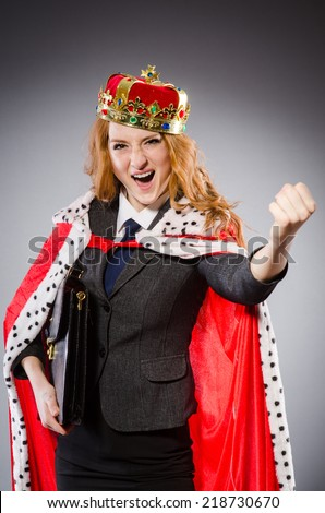 Woman queen businesswoman in funny concept - stock photo