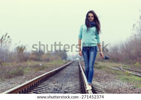 woman railroad blue scarf brunette - stock photo