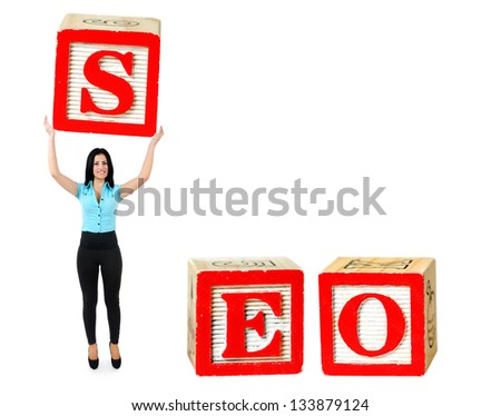 Woman raise letter from word SEO - stock photo