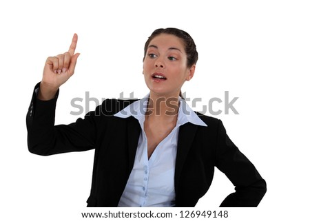 Woman raising her hand - stock photo