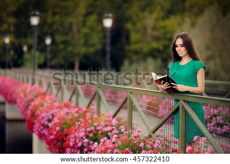 Woman Reading a Book on a Bridge with Flowers - Portrait of a intellectual girl holding a novel  - stock photo
