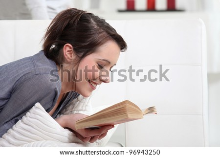 Woman reading at home - stock photo