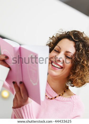 woman reading book at home. Copy space - stock photo