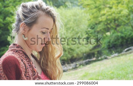 Woman Reading book by tree