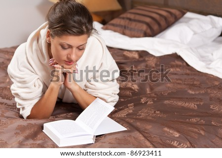 Woman reading book on bedroom