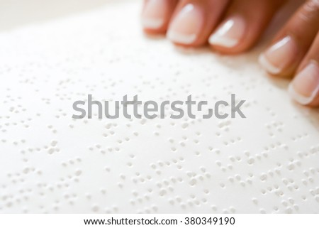 Woman reading braille - stock photo