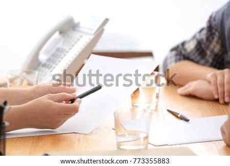 Woman reading document to her client on meeting with consultant, closeup