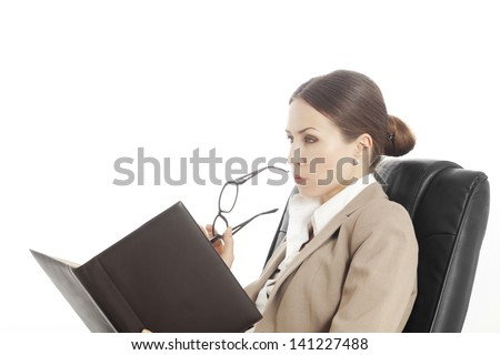 woman reading from notebook