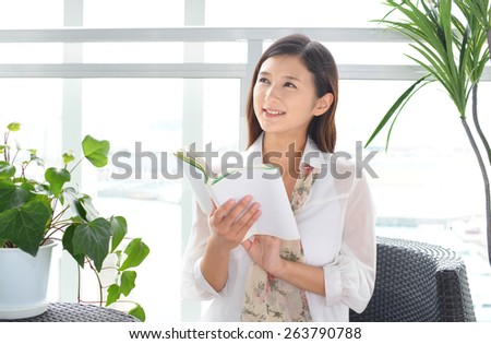 Woman reading her book - stock photo
