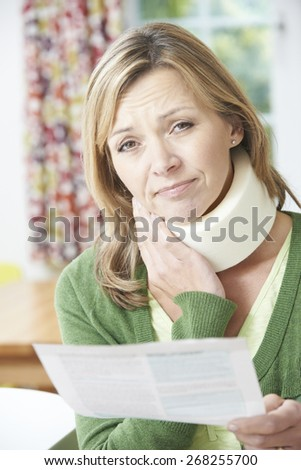 Woman Reading Letter After Receiving Neck Injury - stock photo