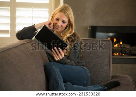 Woman reading on her electronic device