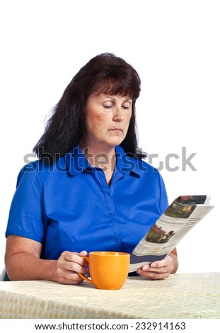 Woman Reading Paper With Coffee Cup