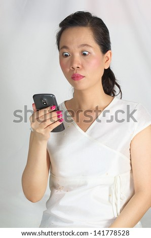 woman reading text on cell phone - stock photo