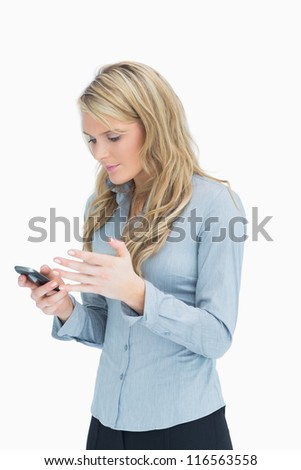 Woman reading the message on her mobile phone - stock photo